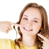 Як можна зміцнити емаль зубів народними засобами